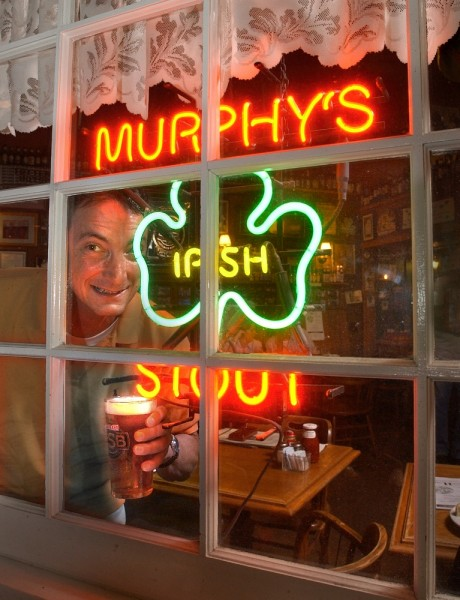 A reveler prepares for St. Patrick's Day at Murphy's Irish Pub in Sonoma. (PD file photo)