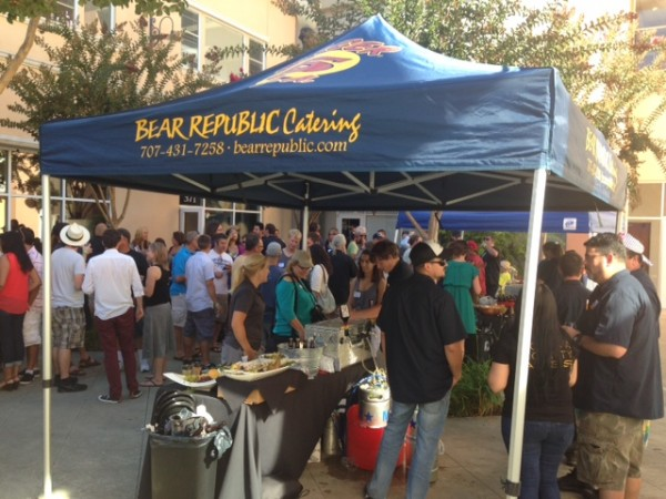 Attendees flock to beer stands at Bear Republic Brewing Co.'s 6th Annual Cellar Party on Sunday next to its brewpub in Healdsburg.